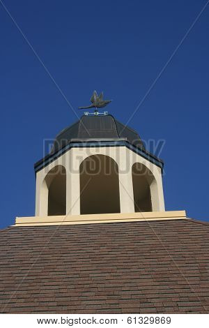 Cupola with Weather Vane and Blue Sky