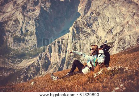 Woman Traveler With Backpack Relaxing In Mountains With Rocks On Background Mountaineering Hiking Sp
