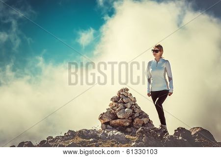 Woman Traveler On Mountain Summit With Stones Way Sign And Clouds Sky On Background Hiking Mountaine