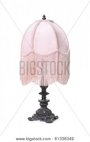 antique lamp with pink lampshade