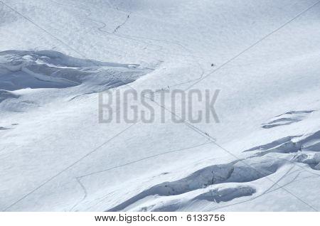 Ski Mountaineers Climbing A Glacier