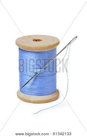 needle with spool of blue thread