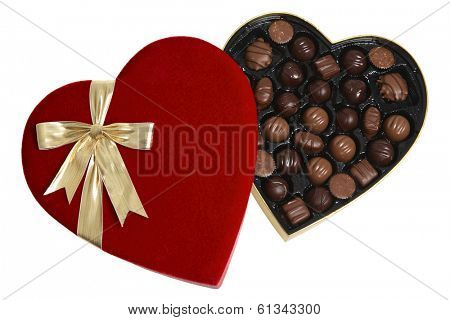 opened red heart shaped box of chocolates