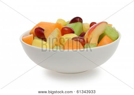 Bowl of fresh fruit on white background