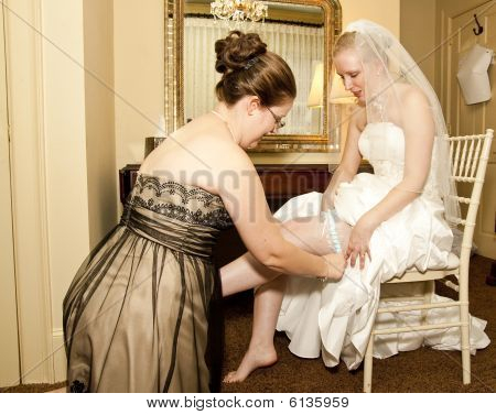 Maid Of Honor Putting On Garter