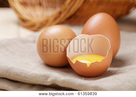 Raw Chicken Eggs One Open With Yolk