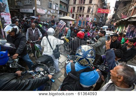 KATHMANDU, NEPAL - DEC 1, 2013: Traffic jam in one of a busy street in the city center. With an area of 50.67 km in Kathmandu city is home to more than 1 million people.