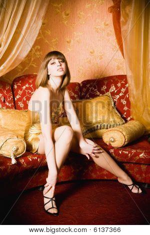 Flirting Young Woman In Short Golden Dress