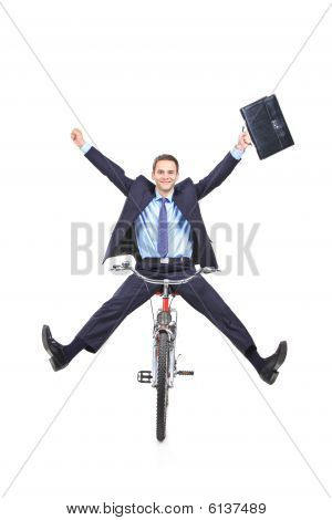 Businessman On Bike Holding A Briefcase