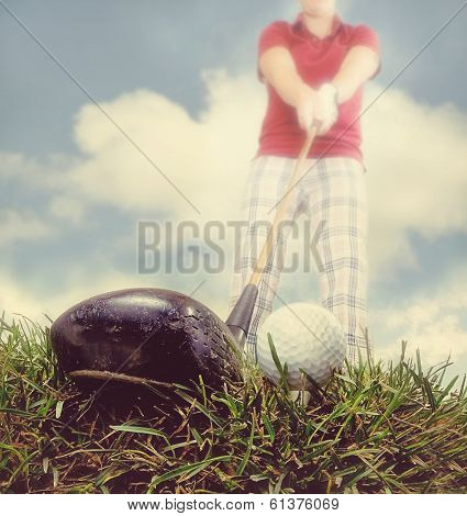 a person playing golf as seen through a wide angle lens done with an instagram like filter