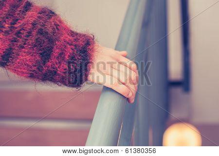 Hand On Banister