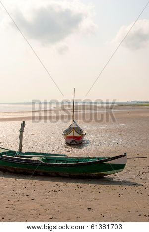 Fishing Boat On The Beach In Low Tide