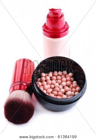 Composition with concealer, powder balls and brush isolated on white