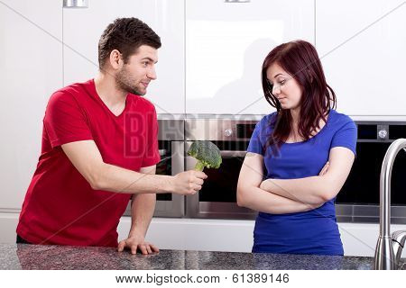 Disgusted Wife Standing In Kitchen