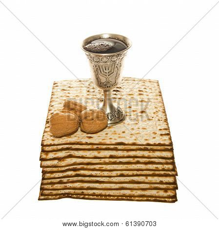 Matzo silver Kiddush cup and three walnuts for Passover Seder