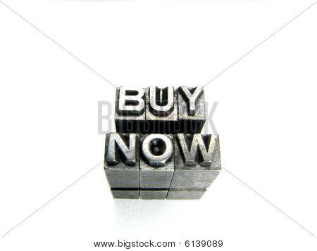 Buy now sign written in vintage letterpress blocks