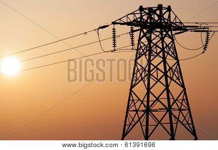 power lines during smoggy sunset