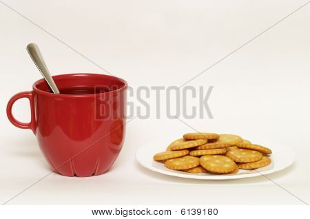 Red Cup With Tea And Plate Of Crackers