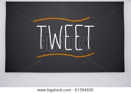 The word tweet written on big blackboard