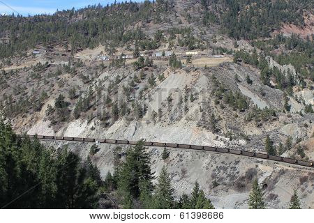 Train passes settlement in mountains