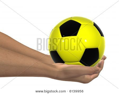yellow and black 3D soccer ball held in hands by an adult male