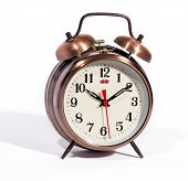 pic of wind up clock  - Classic bronze coloured vintage style alarm clock with bells and a modern dial with a red second hand on a white background - JPG