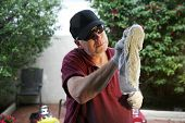 A Professional Window Cleaner uses a cloth towel to detail his freshly washed windows to make them S