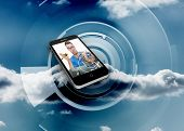 It technician on smartphone screen against cloud on a futuristic structure