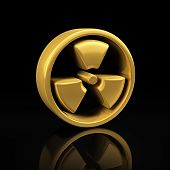 pic of radioactive  - Radioactive danger gold symbol on a black background with reflection - JPG