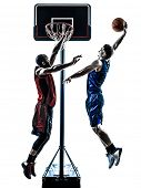 two men caucasian and african basketball players competition jumping dunking in silhouette isolated