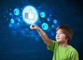 Young boy pressing thumbs up button on modern social network system