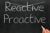 Crossing Out Reactive And Writing Proactive On A Blackboard.