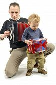 picture of accordion  - child and young man playing the accordion on the white background - JPG