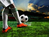 picture of football  - soccer football players in sport stadium with dusky sky background - JPG