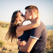stock photo of heterosexual couple  - Young couple in love outdoor - JPG