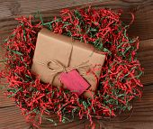 High angle view of a Christmas present wrapped with eco friendly craft paper and tied with twine. Th