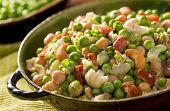 pic of green pea  - A bowl of freshly made pea salad with green peas chick peas cashews green onion bacon celery and creamy ranch dressing - JPG