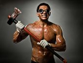 foto of sadistic  - photo crazy frenzied chopper butcher man on dark grey background action with big axe - JPG
