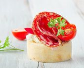 stock photo of baguette  - Baguette With Salami and fresh parsley  - JPG