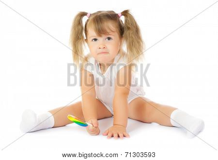 Small smiling girl with lollipop isolated
