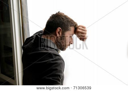 Attractive Man Leaning On Window Suffering Emotional Crisis And Depression