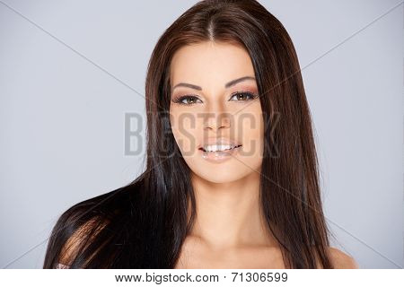 Adorable woman portrait, she looking staight into camera