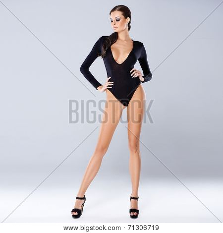 Sexy brunette posing isolated on gray, full body standing shot