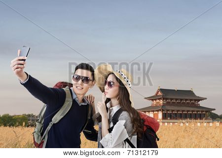Asian couple travel and selfie in Nara Imperial Palace, Nara, Japan.