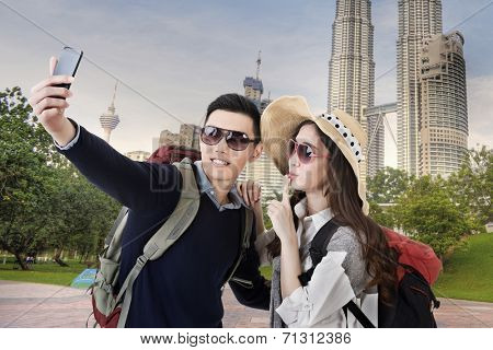 Asian couple travel and selfie in Kuala Lumpur, Malaysia.
