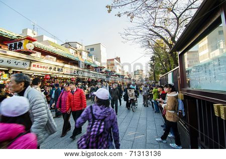 Tokyo, Japan - November 21, 2013: Tourists Visit Nakamise Shopping Street In Asakusa