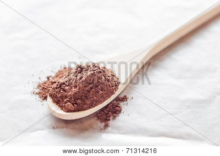 Wooden Spoon Of Cocoa Powder