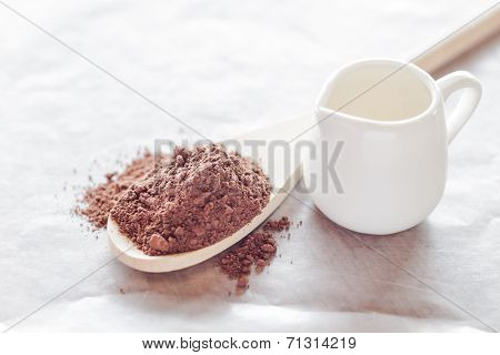 Powdered Cocoa Ingredient And Fresh Milk