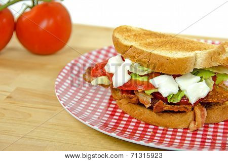 fresh tomatoes with BLT sandwich