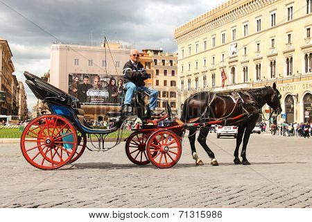 Coachman Sits On A Carriage, Pulled By A Horse, Waiting For Tourists To Piazza Venezia In Rome, Ital